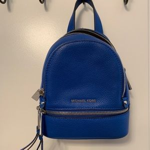 d1fe6a7c06a923 Michael Kors Bags - Michael Kors Mini Blue Backpack